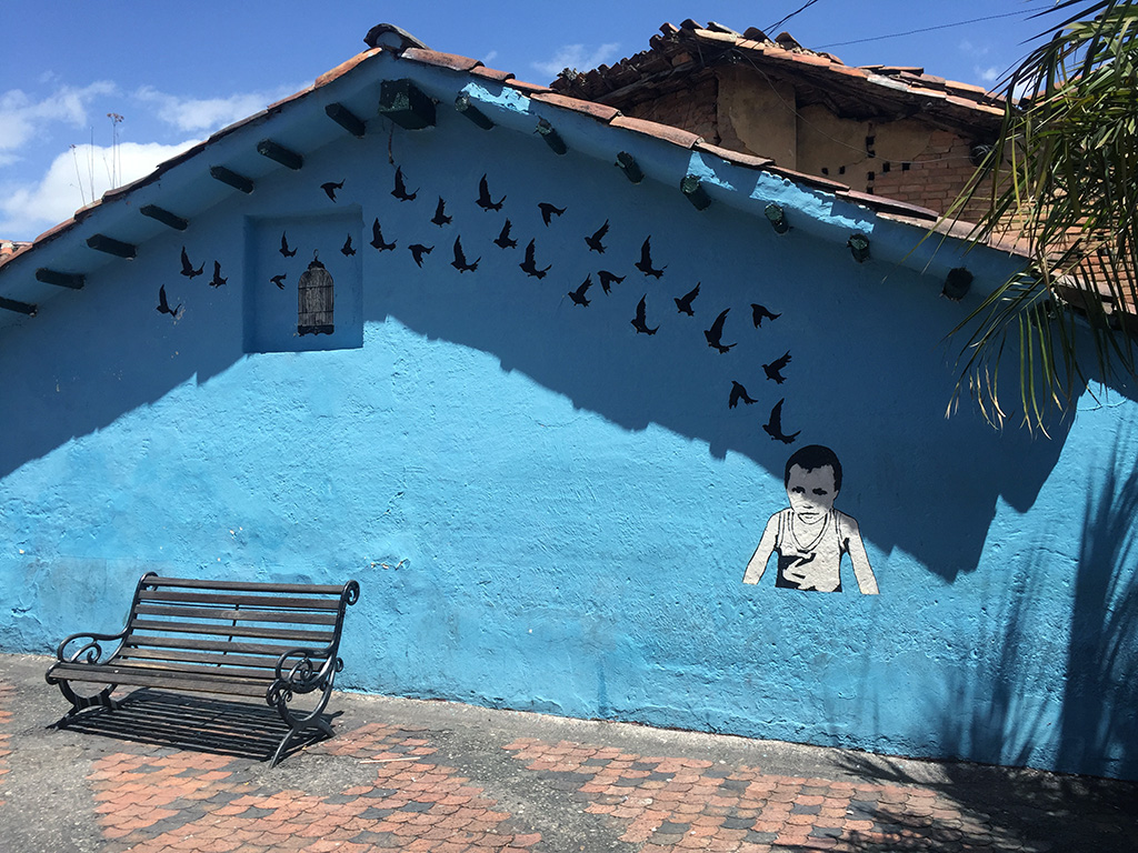 Attending one of the Bogota Graffiti Tours is a must-do activity as early as possible in your vacation so that you can enjoy the street art with a deeper understanding and appreciation throughout the rest of your trip! // dreams-etc.com