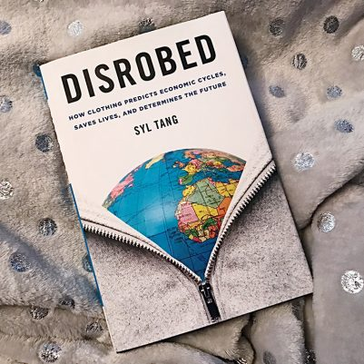 A book review of Disrobed by Syl Tang, how fashion can give insight into what a group of people is thinking or feel, and how it impacts the world. // dreams-etc.com